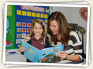 Alison Young, Mt. Helix Academy's Assistant Director, reading to a young student