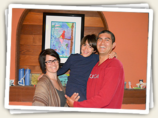 Hillary, son Nolan, and Albert Garibay showing off Nolan's first art project.